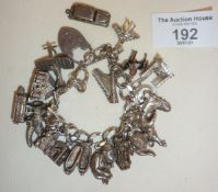 American Sterling silver charm bracelet with padlock marked 'locks of love', hung with many silver