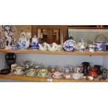 Large collection of assorted small china ornaments and cabinet cups (two shelves)