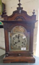 Victorian oak cased mantle clock with arched dial
