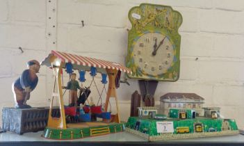 Vintage tin plate clockwork fairground boat ride, a similar tinplate revolving coaches in tunnel