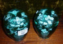 Pair Nailsea green glass dumps having flowers in vase design