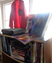 Large collection of books on Elvis Presley (47) and a red Elvis in Concert jacket