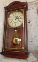 A President quartz Westminster chimes pendulum wall clock in mahogany case (working)