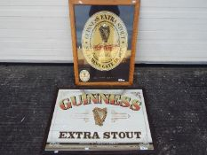 A Guinness Extra Stout advertising mirror,