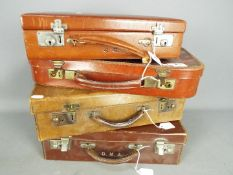 Four good quality vintage cases, all with keys, largest approximately 12 cm x 40 cm x 28 cm.