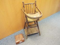 A child's vintage metamorphic high chair / low chair and a wooden box with carved detailing.
