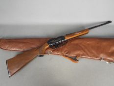 A Rogers, Arkansas Powerline 922 pump action .22 cal air rifle in carry case, serial number G903478.