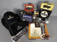 A collection of Guinness branded merchandise to include a fleece jacket, size L, baseball caps,