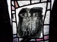 A printed glass panel depicting four ladies, approximately 30 cm x 25 cm.