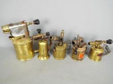 Five brass blow lamps to include Max Sievert, Radius, Serrot and similar.
