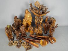 A collection of carved wood figures and similar, many religious themed.
