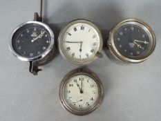 Two Smiths car dashboard clocks and two similar.