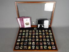 A set of Danbury Mint enamelled pin badges from the 'Diamond Jubilee' collection,