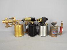 Four vintage blow lamps to include Primus, Brevete Paris, Sadu and similar.