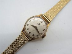 A lady's 9ct gold cased Omega wristwatch with replacement bracelet,