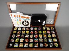 A set of Danbury Mint enamelled pin badges from the 'Beano Collector Pin' series,
