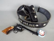 Blank firing pistol with good quality belt and holster and tub of 6mm blank cartridges.