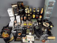 A collection Guinness branded merchandise and promotional items to include glasses,