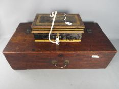 A mahogany box / chest with hinge lid approximately 20 cm x 74 cm x 39 cm and a Milners Safe Comany