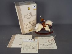 Steiff - a Steiff Teddy Bear with Rocking Horse, # 037337 issued in a Limited Edition.