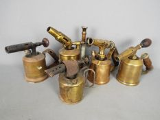 Five brass blow lamps to include Max Sievert, Primus and similar.