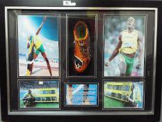 Usain Bolt - A framed sporting montage comprising a Puma running shoe / spike bearing original