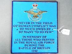 A cast iron RAF commemorative sign, approximately 26 cm x 23 cm.