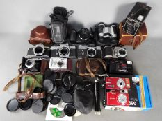 Photography - A collection of cameras and photographic equipment to include a Praktica LLC,