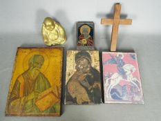 A small collection of religious iconography including a brass Buddha and similar.