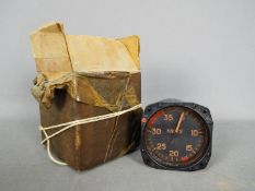A vintage air speed indicator gauge with box marked 'Lancaster X Spares'