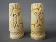 Two carved bone ornamental stands,