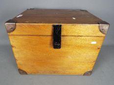 A vintage metal bound chest, approximately 37 cm x 45 cm x 38 cm.