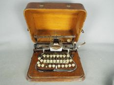 An early 20th century, aluminium 'Featherweight' Blickensderfer typewriter in carry case.