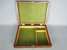 A good quality inlaid wooden box with sectional interior and key,