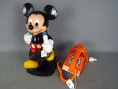 A vintage Tyco Mickey Mouse telephone and a retro orange telephone.