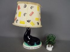 Breweriana - A Guinness advertising table lamp by Carlton Ware modelled as a sealion,