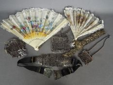 A lot to include mesh purses, silver plated evening belts and other.
