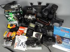 Photographic Equipment - A lot comprising a quantity of cameras and photographic equipment to