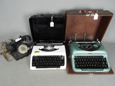 Two portable typewriters, one an Imperial 'Good Companion' and a vintage dial telephone.