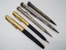 A Parker 61 fountain pen and propelling pencil and three further silver plated propelling pencils.