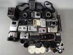 Photography - A collection of cameras and photographic equipment to include a Zenit EM, Pentax P30,