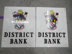 Two c1950's District Bank illuminated sign faces, each approximately 85 cm x 67 cm.