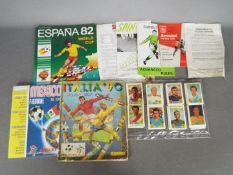 Lot to include a complete Italia 90 World Cup sticker album (Yugoslavian issue), taped,