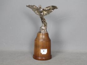 Automobilia - A Finnigans Icarus car mascot designed by Colin George, mounted to wooden plinth,