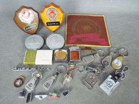 Automobilia - A collection of car badges, motoring related keyrings and pin badges,