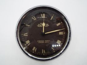 Automobilia - A car dashboard clock marked Jaeger, approx 8.