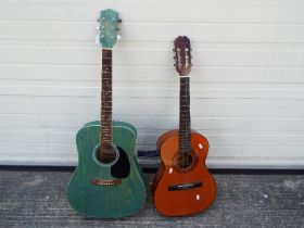 Two acoustic guitars comprising an Earthfire Autumn Leaves and one other.