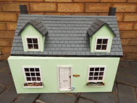 Two scratch built wooden dolls houses. Click on photographs to view each house.
