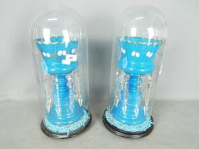 A pair of blue glass lustres with hand painted decoration of gilt and white (quite extensively