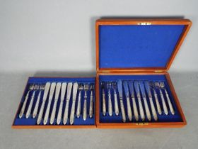 A wooden cased canteen of cutlery.